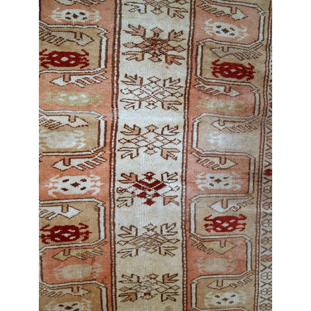 Turkish Oushak runner from the middle of 20th century in unusual tribal design. The rug is very narrow and made in soft...