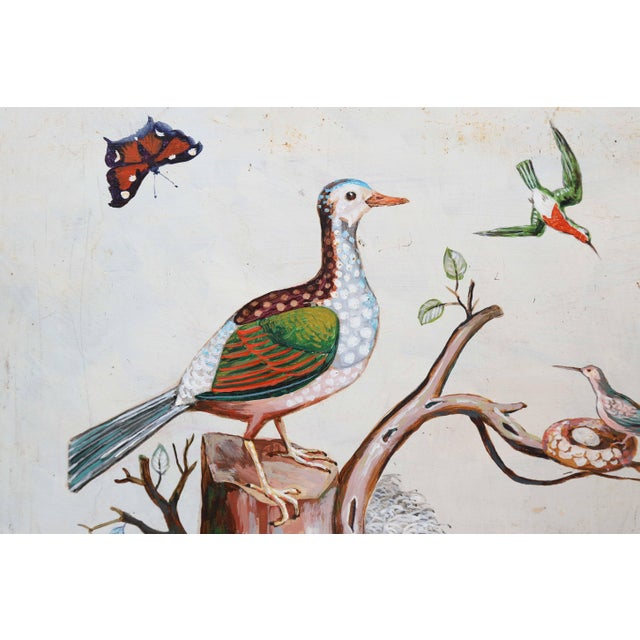 The main focus of this painting is tree stump with a rather large bird perched on it. A hummingbird tends to its nest on a...