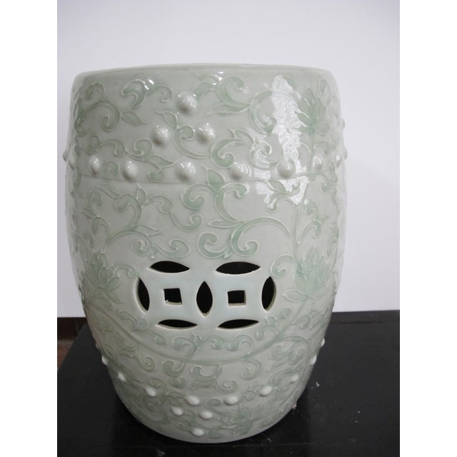 Such a romantic feel to this soft and sweepy design on this ceramic garden stool. Made in China. Useful as a stool, of...