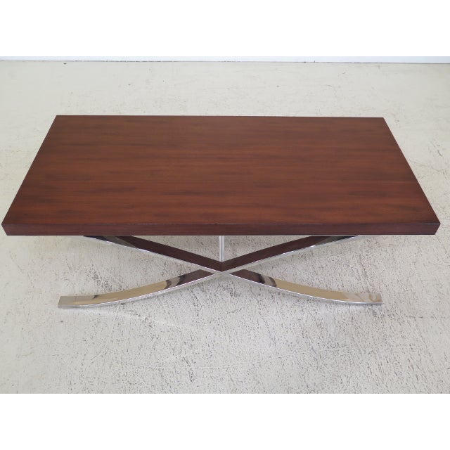 5 year old mid century modern chrome base coffee table. Features quality construction, and a walnut top with polished...