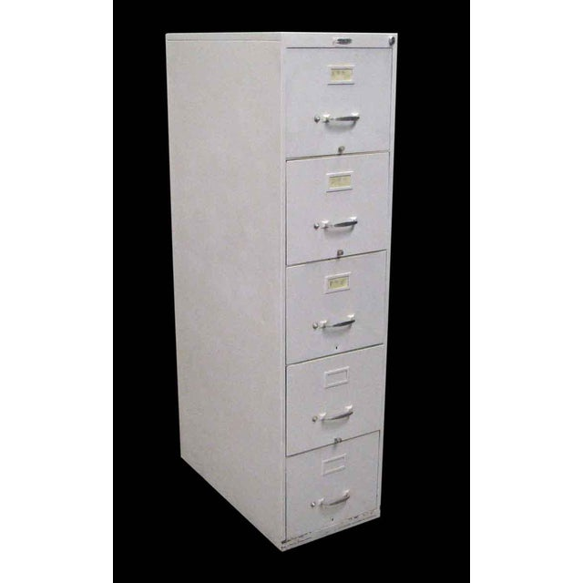 Mid 20th century metal file cabinet with white paint.
