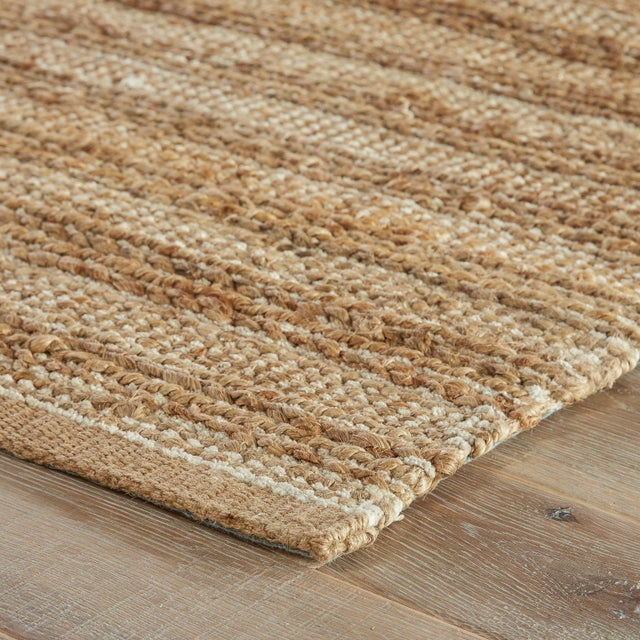 A natural area rug with a contemporary touch, this cotton-backed layer pops with a warm wheat hue and bright white...