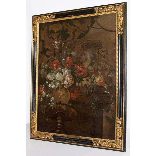 A large still life oil on canvas of red and white flowers set on a dark background in the manner of Pierre Nicolas...