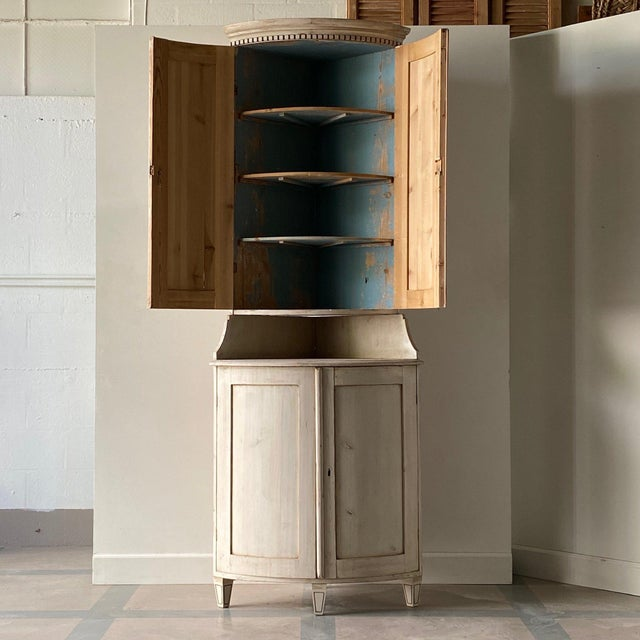 Antique Swedish Gustavian corner cabinet - top section has painted interior and 4 shelves. Height: 92.5″ Width: 34″ Depth:...