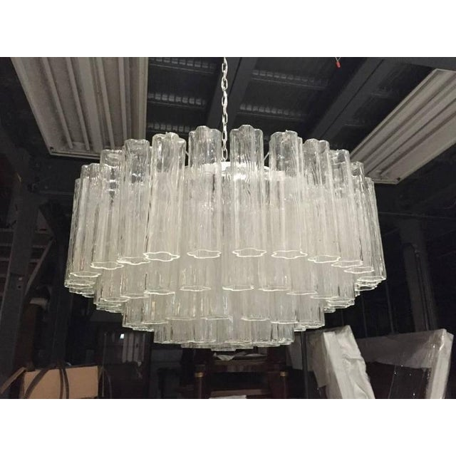 Stunning Italian Mid-Century Modern Tronchi tiered chandelier. Consists of Tronchi cylindrical glass pieces. Each piece is...