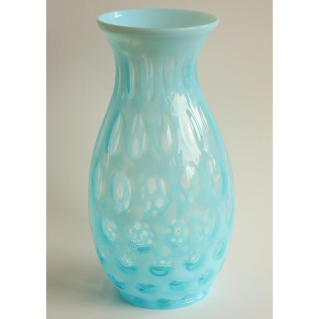 """Vintage glass vase with a striking turquoise coloration and playful spotted """"coin dot"""" motif. Thought to be from the..."""
