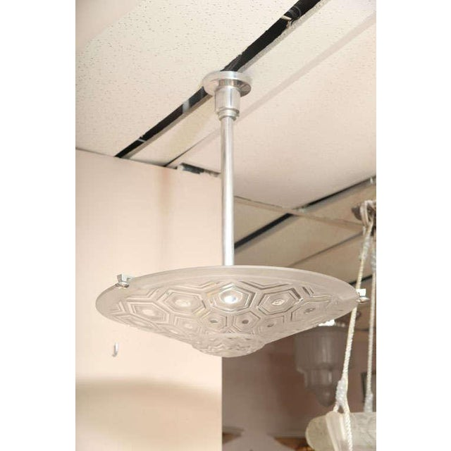 Kovacs Art Déco glass fixture, circa 1930. Mounted in a chromed metal frame. Molded signature A.Kovacs France. H. 21.7...