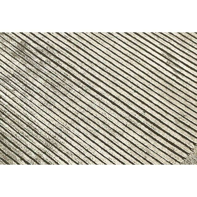 This collection of hand woven contemporary rugs features geometric Tibetan motifs in soft, neutral tones. Woven in a blend...