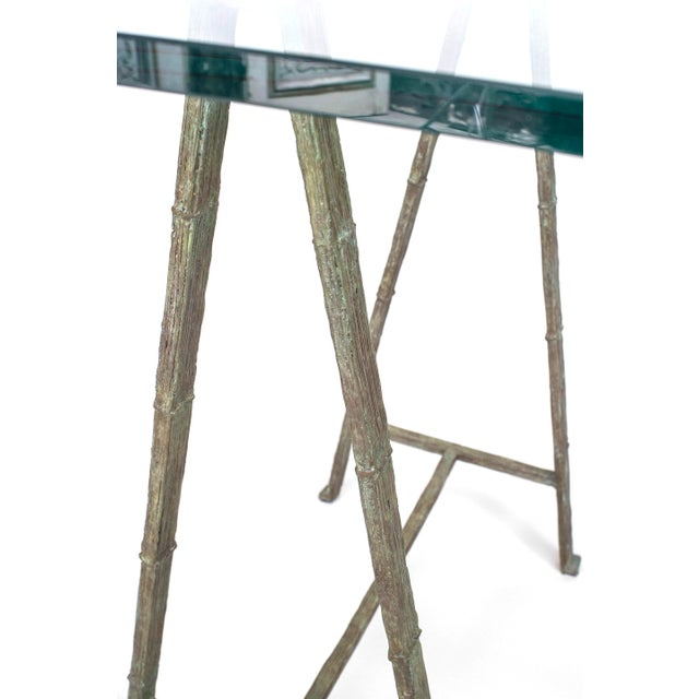 """Post-War Design (Giacometti style) table desk with a Pair of verdigris patina bronze """"A"""" frame sawhorse bases under a..."""