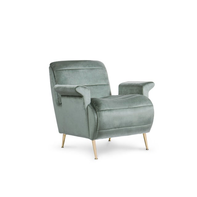 Inspired in the feminine silhouette of Brigitte Bardot, this armchair boasts modern contours, both on the slightly...