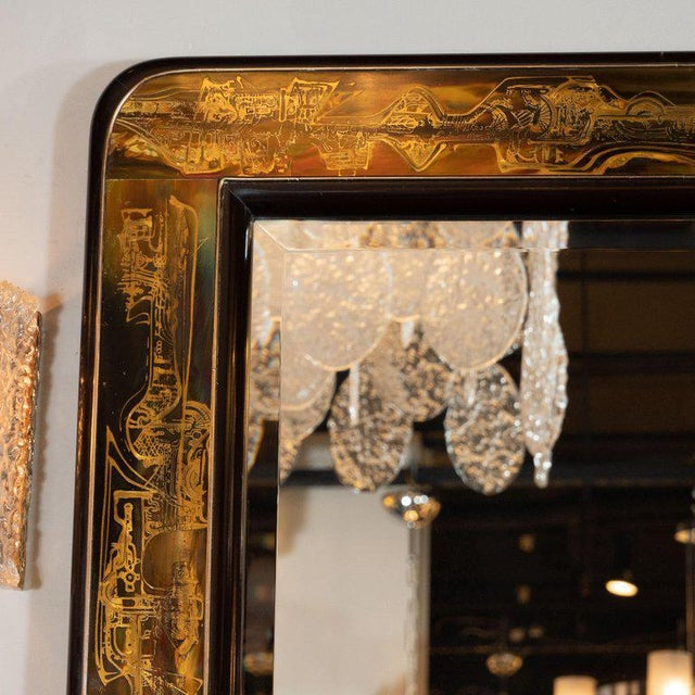 This sophisticated wall mirror designed by Bernard Rohne and realized for the esteemed American maker, Mastercraft, circa...