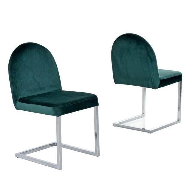 Exquisite chrome cantilever Baughman style dining chairs. The chairs were reupholstered with a luxurious forest green...