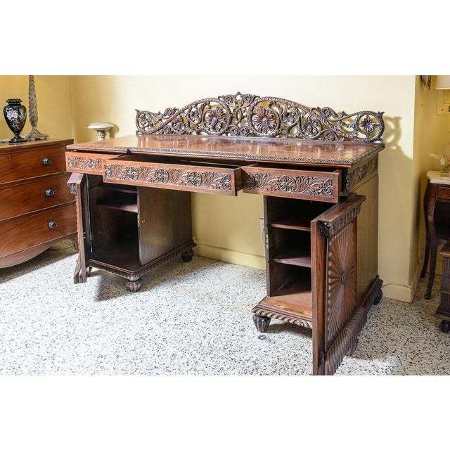 Beautiful, Anglo-Indian server. With wonderful carved details, three drawers, and two bottom cabinets