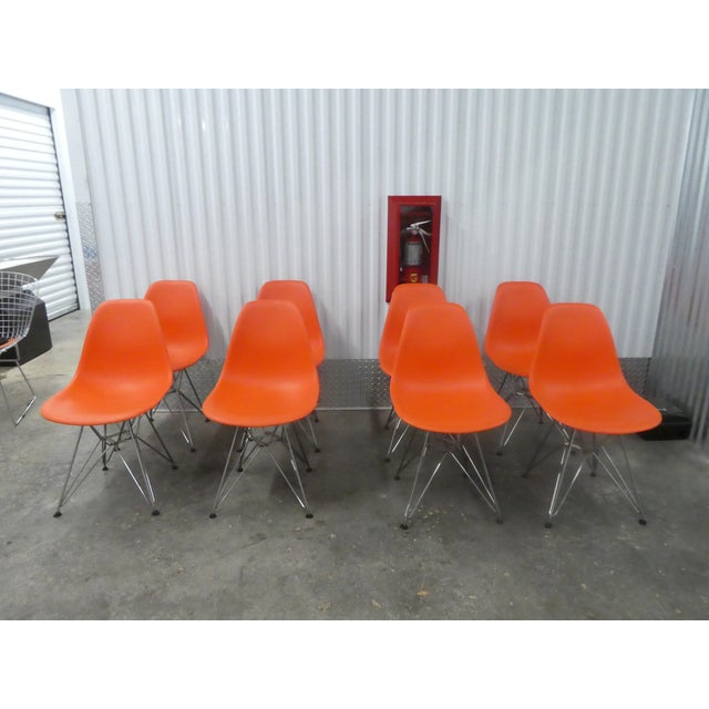 8 Orange Herman Miller Eames Office Eiffel Tower Chairs sold as found in vintage condition lightly used.