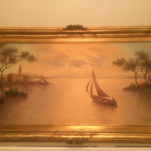 Gorgeous serene sailboat oil on canvas original painting by artist Mario Rossi for sale. Framed in a beautiful ornate wood...