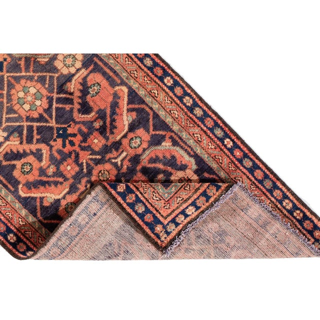 A hand-knotted vintage Persian Malayer rug with a floral design. This piece has great detailing and colors. It would be...
