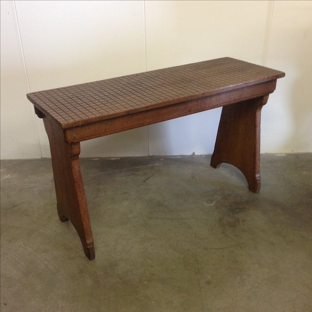 This antique, pine bench from Belgium has a unique, grid-carved top and features a dark stain. It dates back to the early...