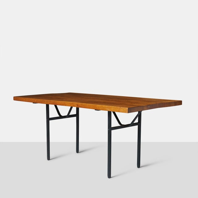 "Jean Touret Dining Table A rectangular dining table by Jean Touret with a 1 3/4"" solid oak top and a black lacquered iron..."