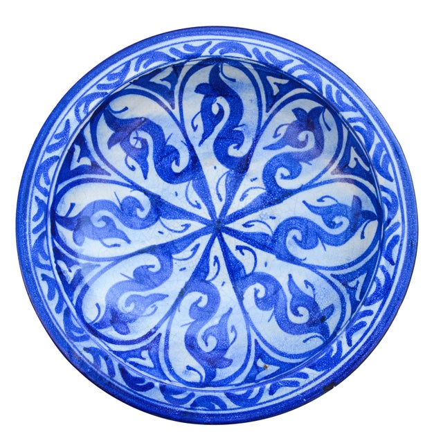 Handcrafted and glazed ceramic plate from Fez, Morocco. Featuring an intricate hand-painted Moorish pattern in blue and...
