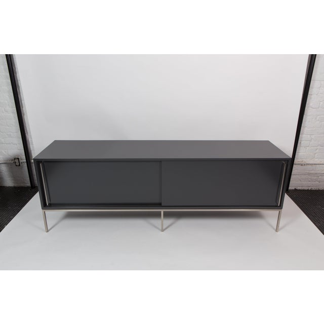 This is a satin version of our re: 379 credenza in Benjamin Moore Wrought Iron lacquer on a satin nickel frame.