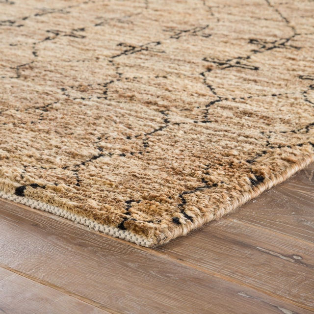 This natural area rug designed by Nikki Chu boasts a stunning combination of global-inspired patterns and plush, organic...