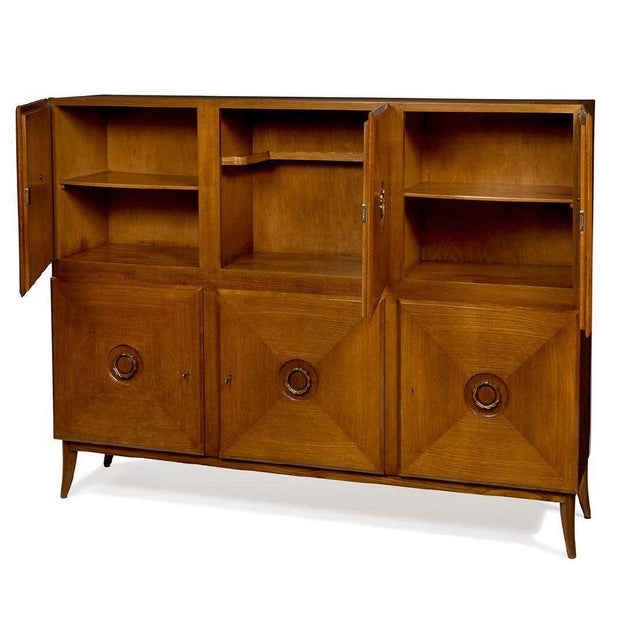 Fine rare Italian cabinet / sideboard in teak with decorative brass pulls designed by Paolo Buffa. Circa 1940's Stamped...