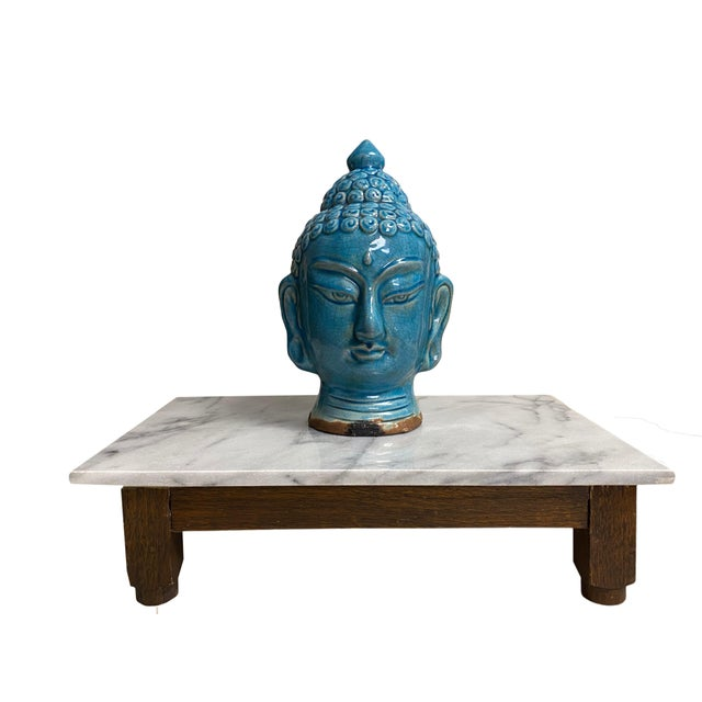 A wonderful blue glazed Buddha head makes for a fun addition to any room! Appears to be terra-cotta with a mark on bottom.