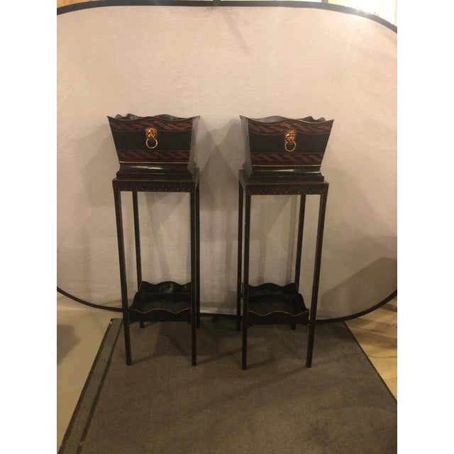 A beautiful pair of Georgian style tole hand-painted jardinières or planters featuring black, brown and rose gold colors...