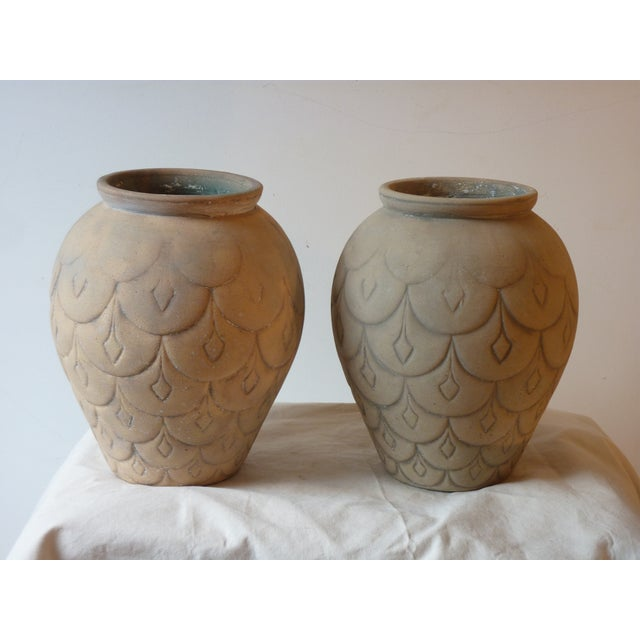 Pair of mid-century ceramic garden urns with incised decoration, nicely weathered, can be planted in, priced for the pair.