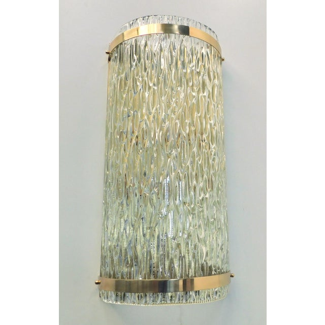 Italian wall light or flush mount with clear Murano glass and beautiful textured design on polished brass frame by Fabio...