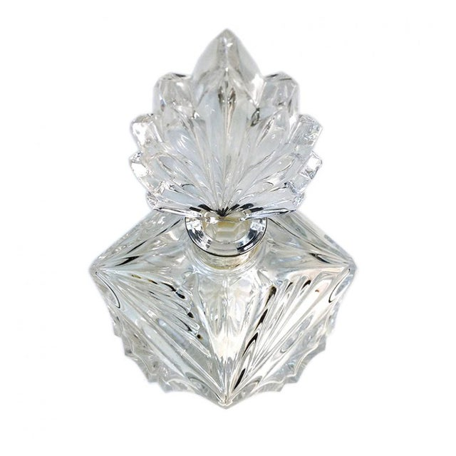 This brilliant, transparent press-cut Art Deco style glass perfume bottle with a large stopper. Body: 4 x 4 x 3.25 inch;...