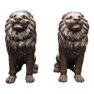 Pair of Bronze Lion Statues For Sale