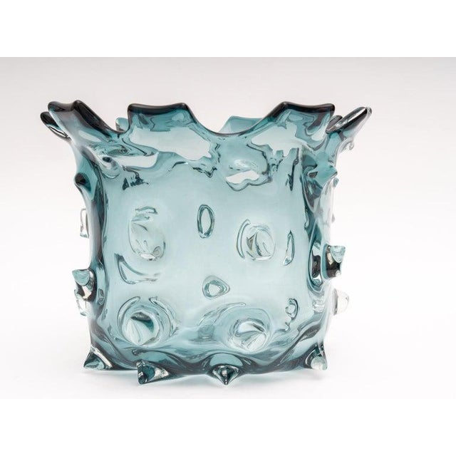 This stylish Murano glass vase was acquired from a Palm Beach estate and was created by the firm of Barovier et Toso. For...