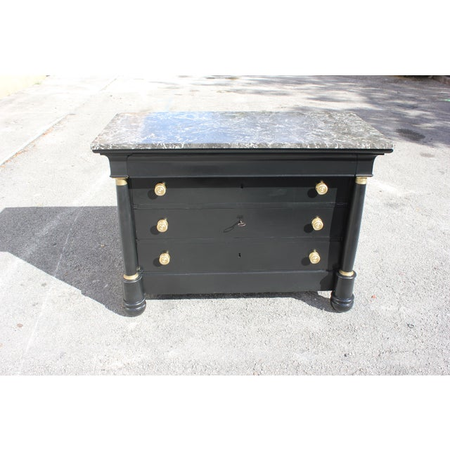 Fine French empire chest of drawers ebonized marble top circa 1900s. Long French empire antique chest of drawers made of...
