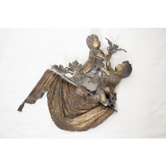 Antique Brass & Spelter Putti/Cherubs with Bird Ledge Mount, designed in two pieces to be mounted onto the ledge of a...