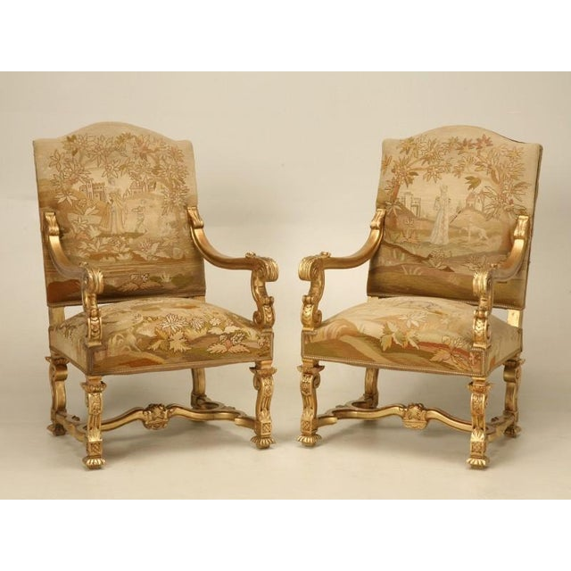 Pair of antique French Louis XIV style throne chairs retaining their  beautiful original hand-stitched - Distinguished Antique French Gilded Throne Chairs Circa 1900 - A