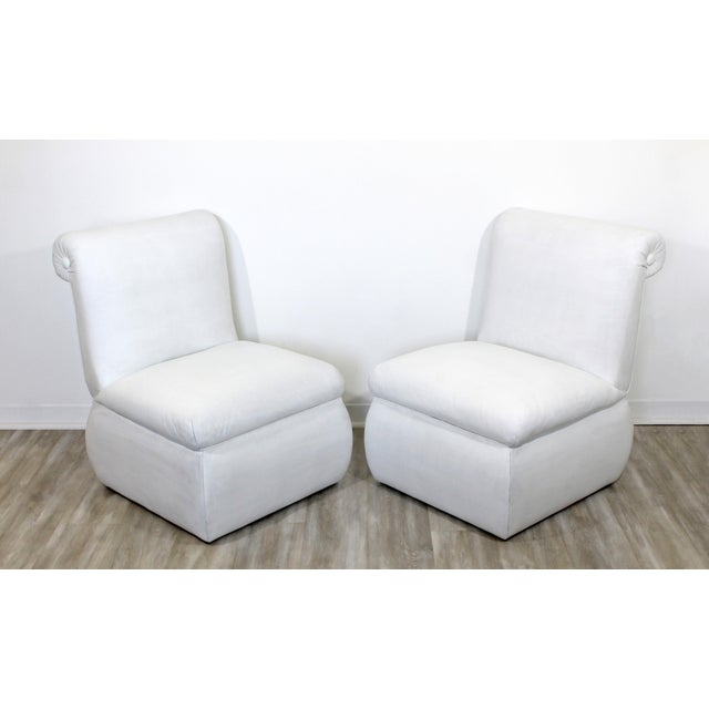 For your consideration is a stunning pair of, white leather, side or accent chairs, circa 1980s. In good condition. The...