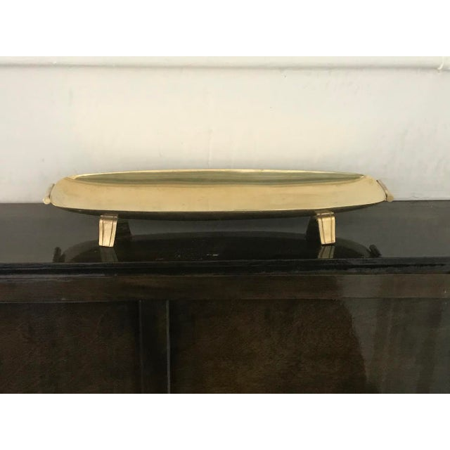 Stunning footed long brass tray stamped Dorlyn. In good condition, polished. Great for keys, change or jewelry!
