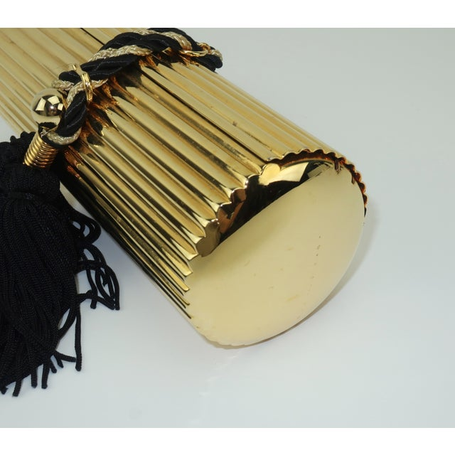 Walborg Gold Metal Cylinder Handbag With Black Tassel Closure For Sale - Image 12 of 13