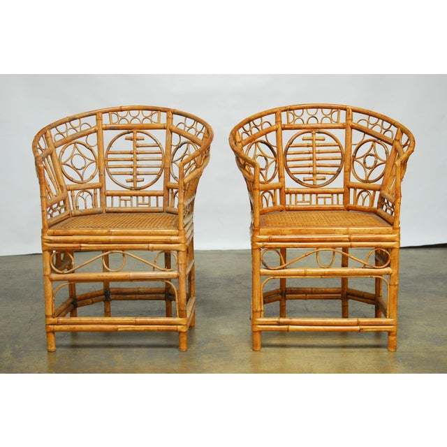 Stunning pair of Brighton Pavilion style Chinese Chippendale chairs with a bamboo horseshoe shape. Featuring an intricate...