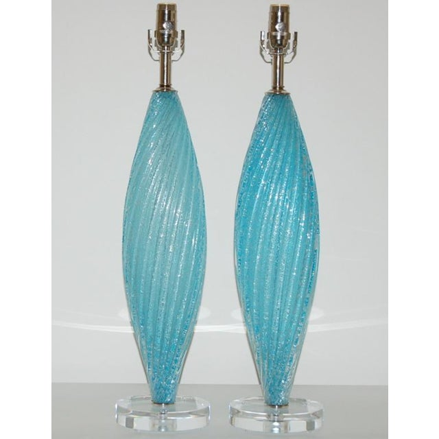 Spectacular AQUA BLUE lamps chock full of tiny little bubbles, in a flat oval shape. Mounted on a chunky Lucite base, with...