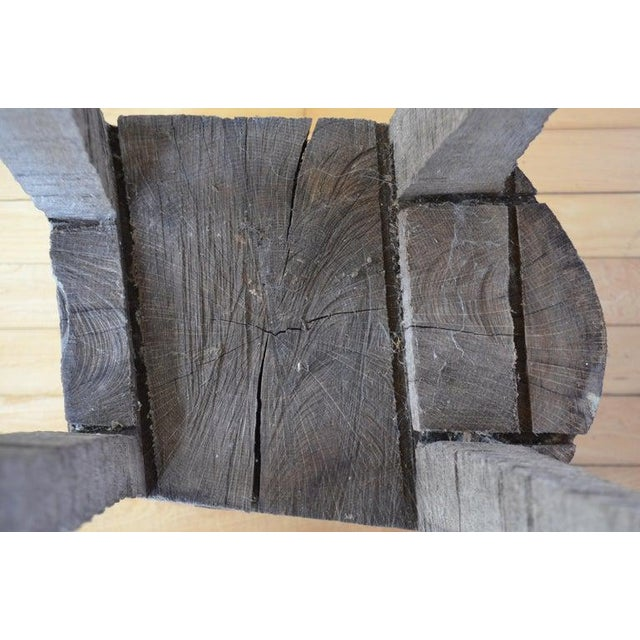 Primitive chopping or butcher block carved in one piece from fallen maple tree. Includes slots for knives. More sculptural...