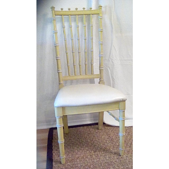 Striking pair of unique faux bamboo side chairs. 1970s original yellow and white finish, original white seat covers,...