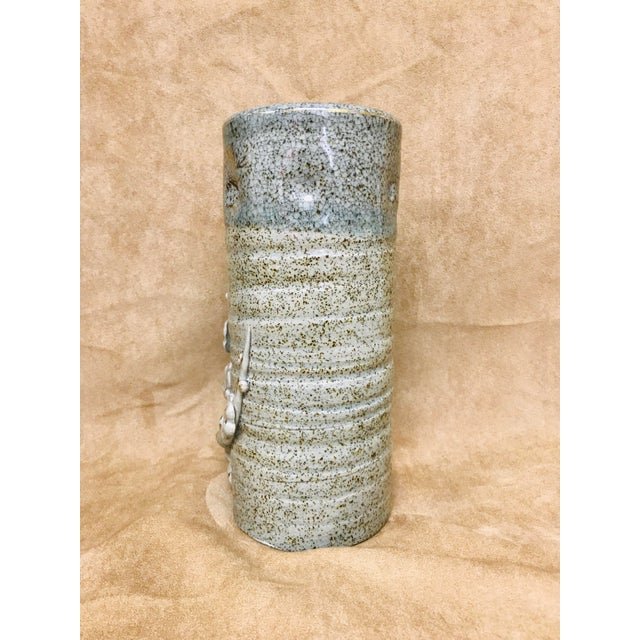Hand crafted vintage brown speckled crackled glaze cylindrical vase in a grey and blue. Floral details, dumpling and hand...