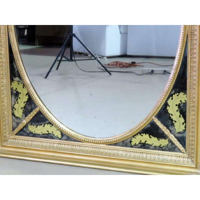 Antique Regency style mirror with gilt frame and reversed painted glass.