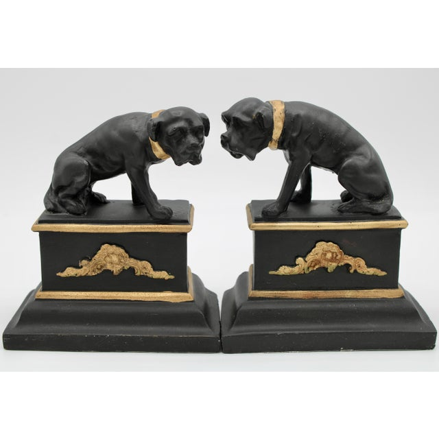 A fine set of Black and Metallic Gold Ceramic Dog Bookends, circa 1950. Ornate design, empire style. Black felt on the...