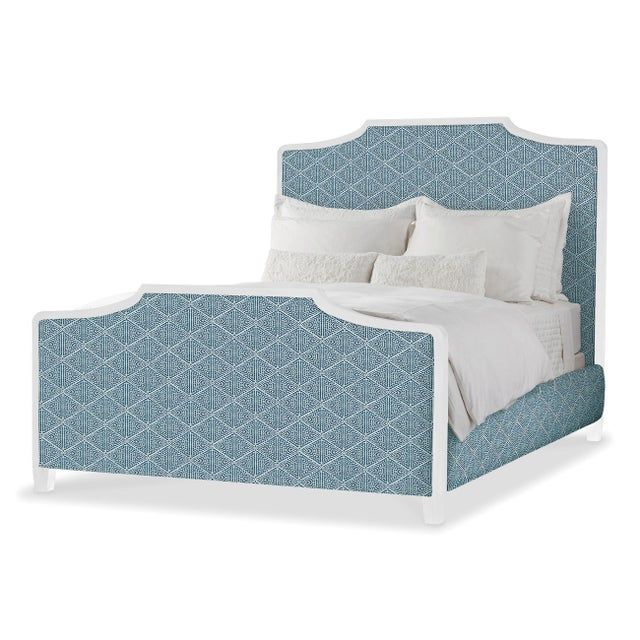 Tall head and footboards add graceful allure to this upholstered bed. It shows off an exposed wood frame that adds a...