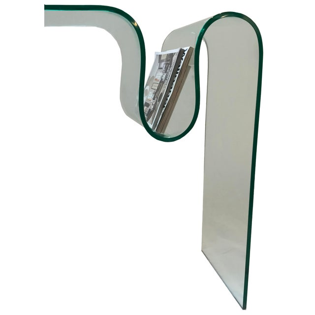 Solid glass bent into this is sculptural yet functional piece that can be used as either a console table or desk. It has a...