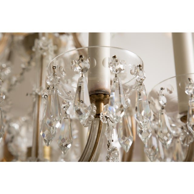 This is a Classic Maria Theresa twelve-light crystal chandelier, circa 1930.