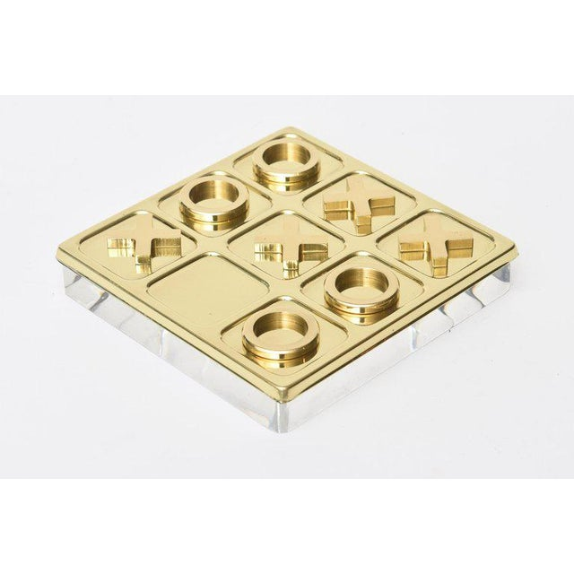 This vintage brass tic tac toe set / game has a new Lucite base that is not attached. It is Mid-Century Modern and was all...